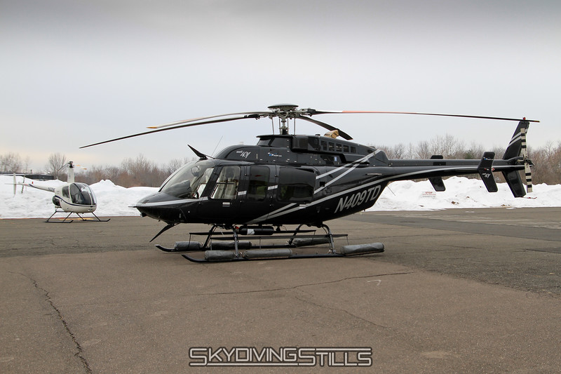 Bell 407 N409TD.  Nope, he wouldn't let us jump it. 2/12/11