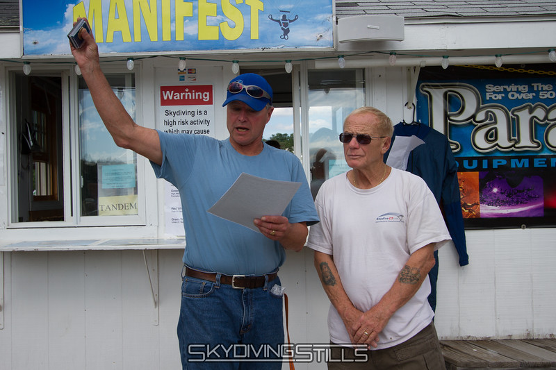 Larry receives his 5000 jump wings from Al.