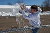 Alex catches a snowball.