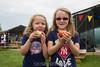 The gals enjoy their apples.