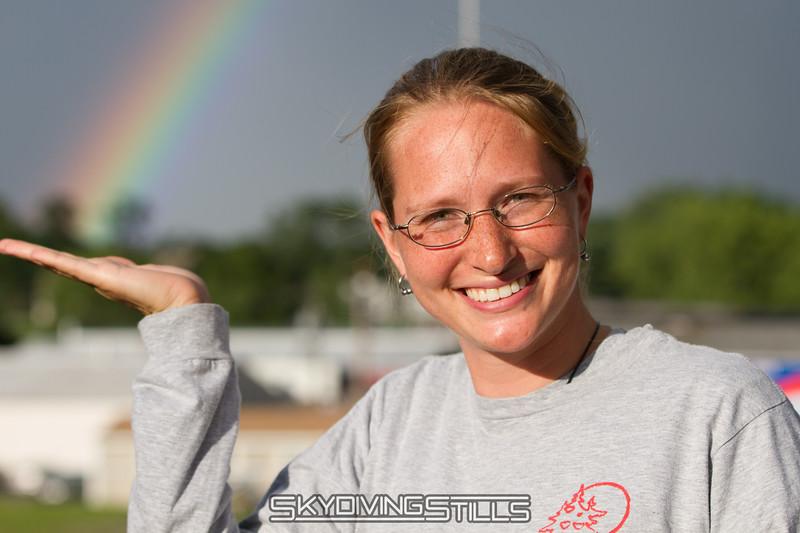 Sarah holds a rainbow.
