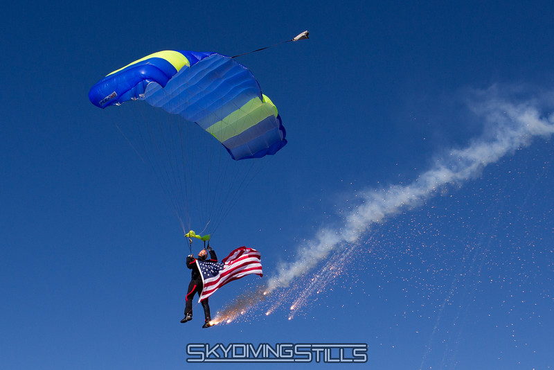 Dave's smoke and flag jump. Published in Parachutist, Featured Jumper, January 2014.