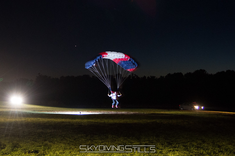 Will touches down on a night jump.