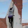 Melissa climbs the tail.