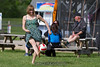 Barefoot soccer in a dress.