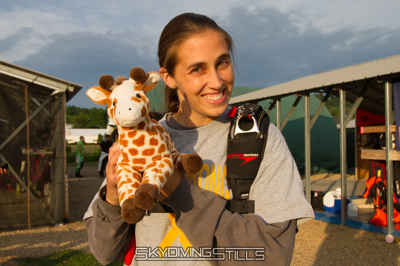 Becky and the giraffe she bought for a sick kid.