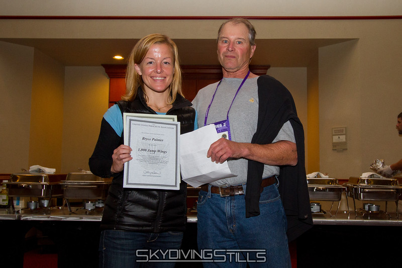 "Bryce receives her 1000 jump wings from Al. Published in Parachutist, January 2016. <br><span style=""font-size:14px"">2015-10-02_skydive_cpi_0380</span>"
