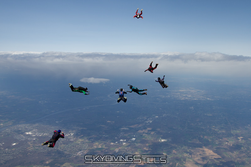 """Lauren docks with Jim on the hill.<br><span style=""""font-size:14px"""">2015-05-03_skydive_cpi_0521</span>"""