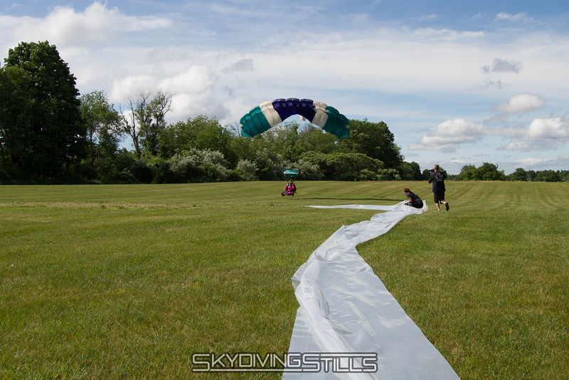 """Slip n' slide being set up for the SIS weekend!<br><span class=""""skyfilename"""" style=""""font-size:14px"""">2015-06-13_skydive_cpi_0006</span>"""