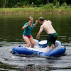 """Either a dance off or trying to shake each other off the float.<br><span class=""""skyfilename"""" style=""""font-size:14px"""">2015-09-13_pond_0334</span>"""