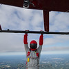 """Paul hangs from the skid.<br><span class=""""skyfilename"""" style=""""font-size:14px"""">2015-08-09_skydive_cpi_0048</span>"""
