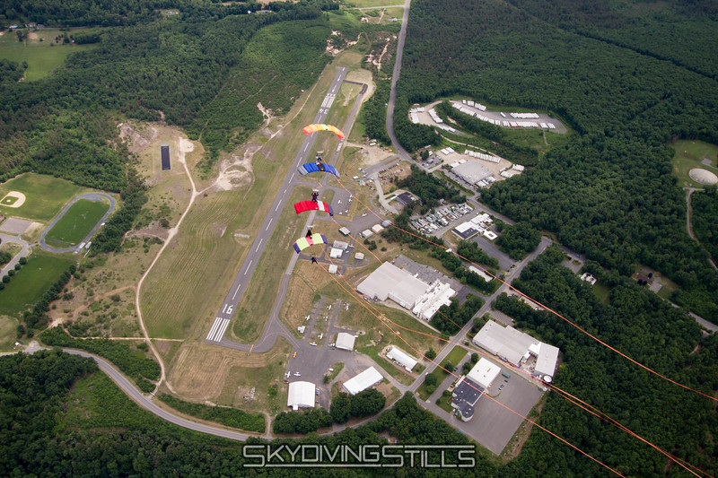 "4-Stack over Turners Falls, MA.<br><span class=""skyfilename"" style=""font-size:14px"">2015-06-20_skydive_jumptown_0261</span>"