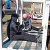 "Monqique and Bryce prep the mockup for paint while Sarah and Melissa do some landscaping. <br><span class=""skyfilename"" style=""font-size:14px"">2016-03-19_skydive_cpi_0087</span>"