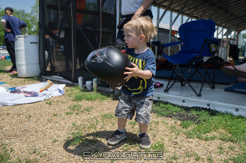 """Breccan brings daddy his helmet. <br><span class=""""skyfilename"""" style=""""font-size:14px"""">2016-05-28_skydive_cpi_0008</span>"""