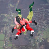 "Cindy tackles the Grinch. <br><span class=""skyfilename"" style=""font-size:14px"">2017-11-18_skydive_cpi_0177</span>"