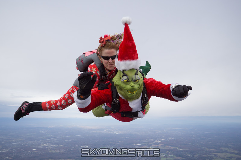 "Cindy jumps on the Grinch's back. <br><span class=""skyfilename"" style=""font-size:14px"">2017-11-18_skydive_cpi_0057</span>"