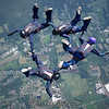 """UConn True Blue 4-way. <br><span class=""""skyfilename"""" style=""""font-size:14px"""">2017-09-04_skydive_cpi_0321</span>"""
