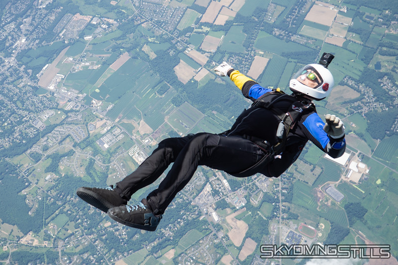 """Tad exits on his back. <br><span class=""""skyfilename"""" style=""""font-size:14px"""">2018-07-04_skydive_cpi_0243</span>"""