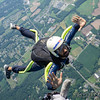 """Joel exits on a hop n' pop. Yes, I'm giving him the finger, but it's for safety reasons. <br><span class=""""skyfilename"""" style=""""font-size:14px"""">2018-07-04_skydive_cpi_0396</span>"""