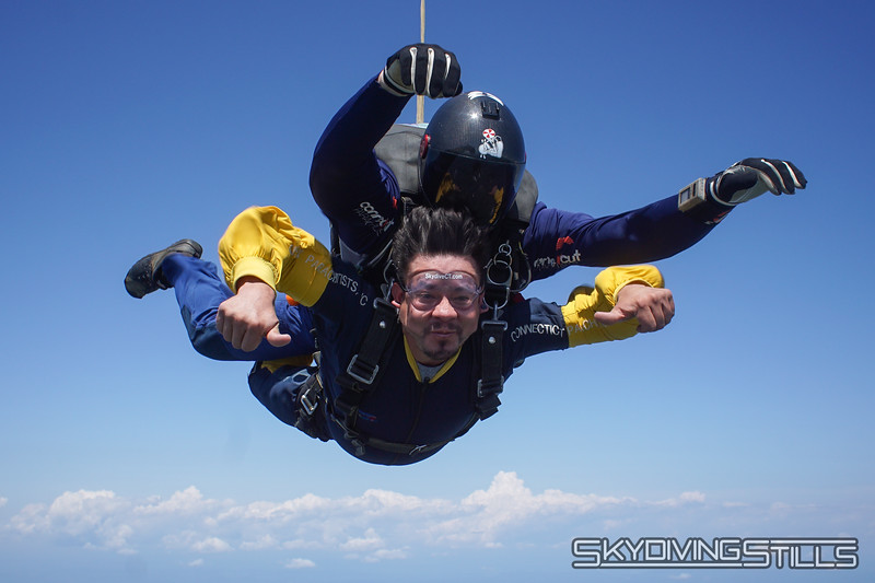 """Luis' tandem with Mike. <br><span class=""""skyfilename"""" style=""""font-size:14px"""">2019-08-04_skydive_cpi_0496</span>"""
