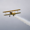 Carl starts off the ceremony with a surprise low pass in his Stearman.