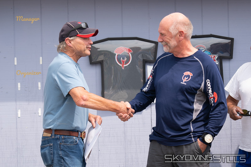 "Mike gets a handshake for 108 hours of freefall. Published in Parachutist, November 2018. <br><span class=""skyfilename"" style=""font-size:14px"">2018-08-25_skydive_cpi_0482</span>"