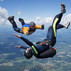 """One more barrel roll. Published in Parachutist, January 2017, Featured Training Photo. Published on the cover of the 2019-2020 Instructional Rating Manual. <br><span class=""""skyfilename"""" style=""""font-size:14px"""">2016-08-07_skydive_cpi_0116</span>"""