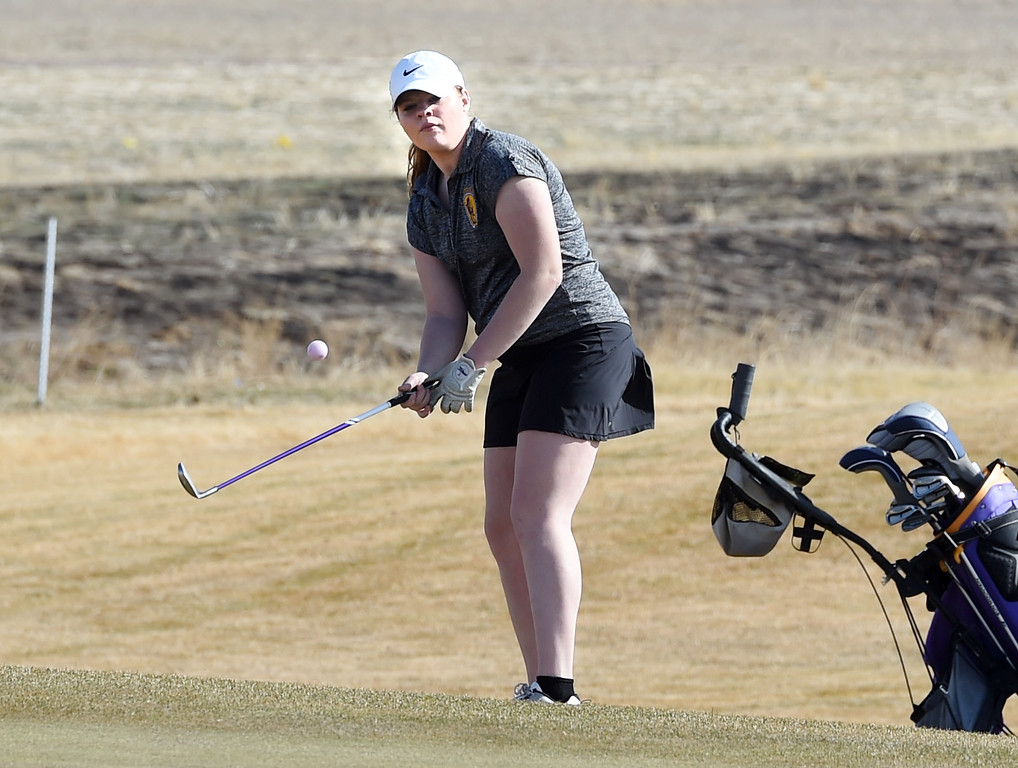 . Sydney Arthur, of Boulder High, chips on to the green during the Skyline Invitational Girls Golf Tournament in Firestone on Wednesday.  For more photos, go to www.BoCoPreps.com. Cliff Grassmick  Staff Photographer March 15, 2017