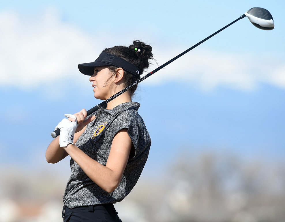 . Payton Williams, of Boulder High, watches her tee shot during the Skyline Invitational Girls Golf Tournament in Firestone on Wednesday.  For more photos, go to www.BoCoPreps.com. Cliff Grassmick  Staff Photographer March 15, 2017