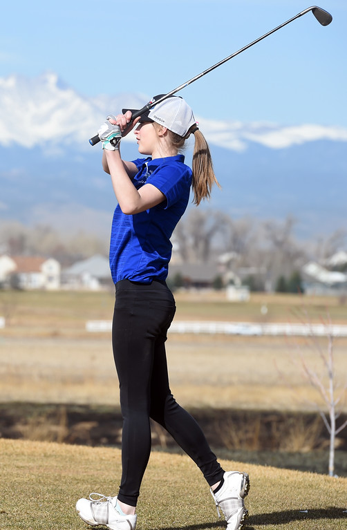 . Mckenna Ertle, of Broomfield High, watches her tee shot during the Skyline Invitational Girls Golf Tournament in Firestone on Wednesday.  For more photos, go to www.BoCoPreps.com. Cliff Grassmick  Staff Photographer March 15, 2017