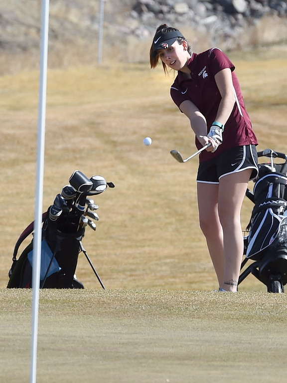 . Shannyn McEntee, of Berthoud, chips on to the green during the Skyline Invitational Girls Golf Tournament in Firestone on Wednesday.  For more photos, go to www.BoCoPreps.com. Cliff Grassmick  Staff Photographer March 15, 2017