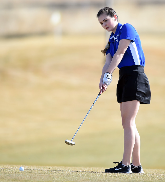 . Shannyn McEntee, of Centaurus High, putts during the Skyline Invitational Girls Golf Tournament in Firestone on Wednesday.  For more photos, go to www.BoCoPreps.com. Cliff Grassmick  Staff Photographer March 15, 2017