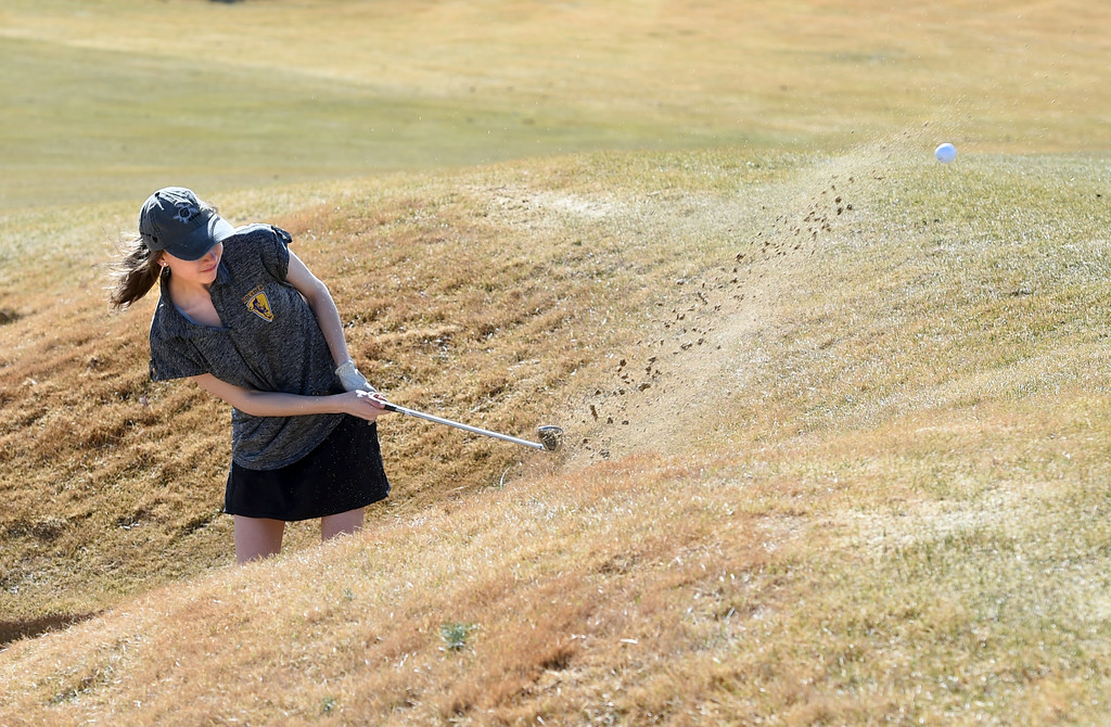 . Laura Osborne, of Boulder High, comes out of the sand during the Skyline Invitational Girls Golf Tournament in Firestone on Wednesday.  For more photos, go to www.BoCoPreps.com. Cliff Grassmick  Staff Photographer March 15, 2017
