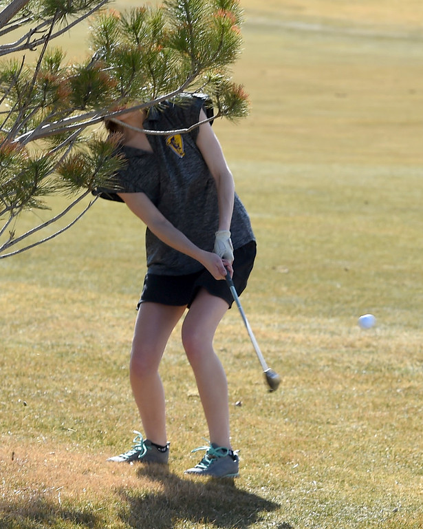 . Laura Osborne, of Boulder High, comes out from under a tree during the Skyline Invitational Girls Golf Tournament in Firestone on Wednesday.  For more photos, go to www.BoCoPreps.com. Cliff Grassmick  Staff Photographer March 15, 2017