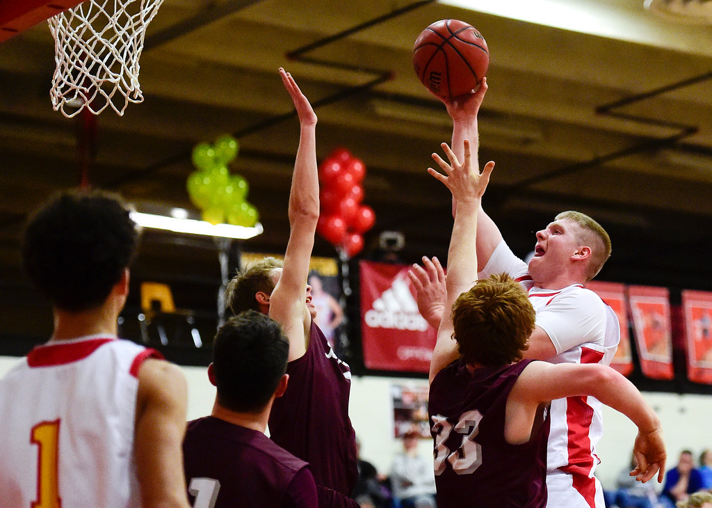 . LONGMONT, CO - FEBRUARY 15:Skyline High School\'s Austin Robison (No. 13) shoots over Berthoud High School\'s Benjamin Burkett (No. 33) in Longmont on Feb. 15, 2019. (Photo by Matthew Jonas/Staff Photographer)