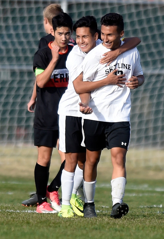 . Skyline High School\'s Alejandro Toledo is congralutated on a goal by teammate Luis Bustos during a game against Erie on Monday in Longmont. For more photos go to BoCoPreps.com Jeremy Papasso/ Staff Photographer/ Oct. 16, 2017