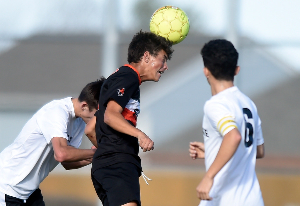 . Erie High School\'s Iago Rohloff heads the ball during a game against Skyline on Monday in Longmont. For more photos go to BoCoPreps.com Jeremy Papasso/ Staff Photographer/ Oct. 16, 2017