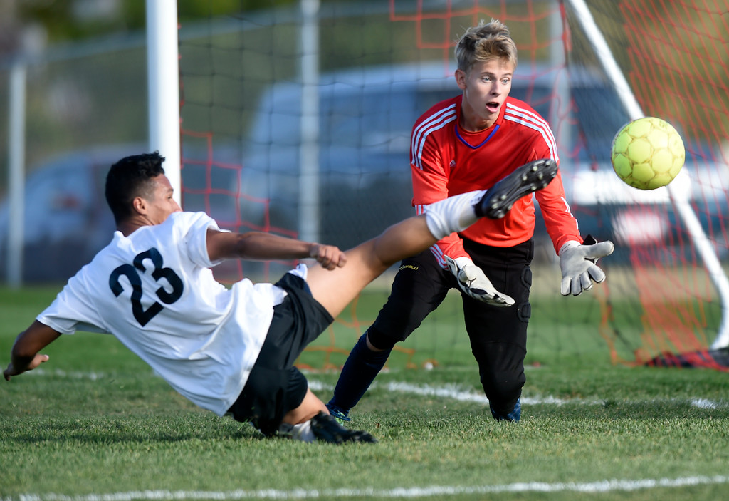 . Erie High School goalkeeper Jon Powell misses a save on Alejandro Toledo during a game against Skyline on Monday in Longmont. For more photos go to BoCoPreps.com Jeremy Papasso/ Staff Photographer/ Oct. 16, 2017