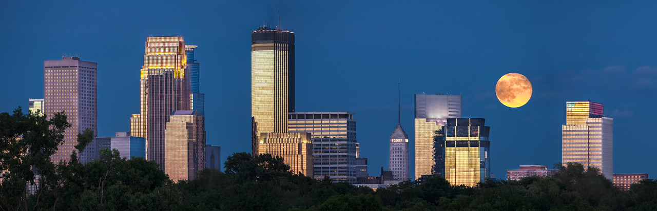 The 2013 June Super Moon and Minneapolis Skyline as viewed from Theo Wirth Parkway.