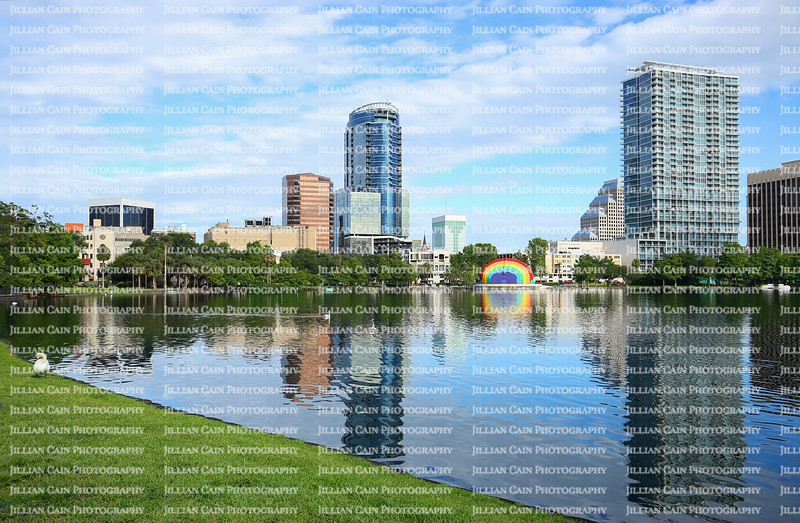 Downtown Orlando's skyline reflects into the glistening waters of Lake Eola.