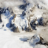 Ruth Glacier cutting through steep mountain ridges south of Mount McKinley, Alaska