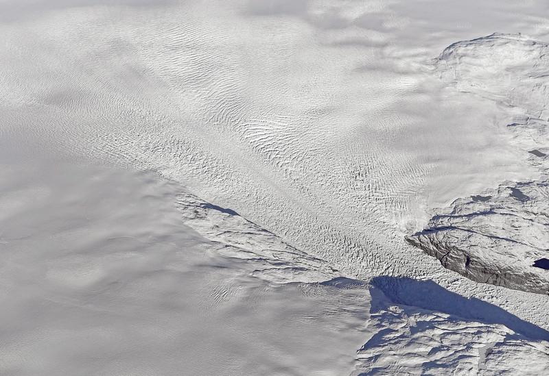 Pattern of crevasses in massive inland glacier disintegrating into the inner Nordre Sermilik fjord in southwest Greenland