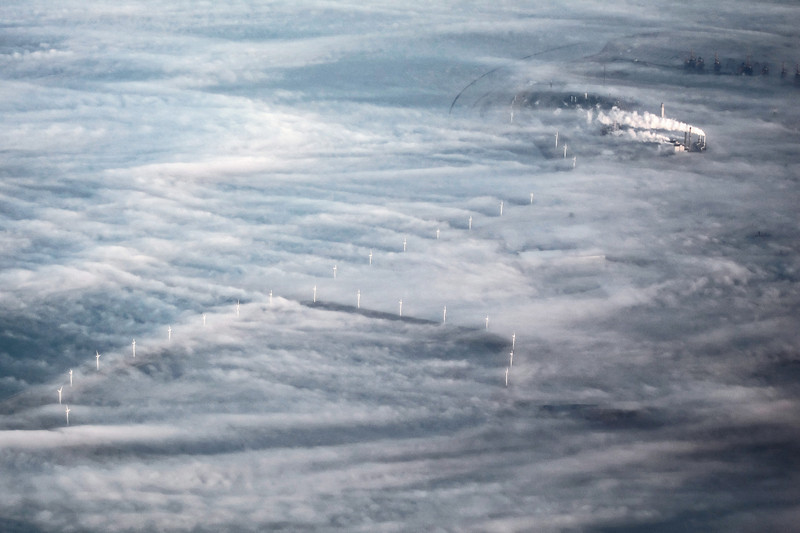 Coastal windmills in ground fog, The Netherlands