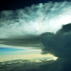 Large thundercloud anvil dissipating over the coast of Gabon