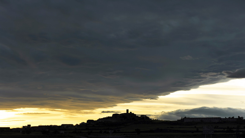 Storm front over the village of Bellver d'Osso in the southern Pyrenees, Spain