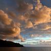 Sunset rays illuminating cloud formations above the island of Lipari, Italy