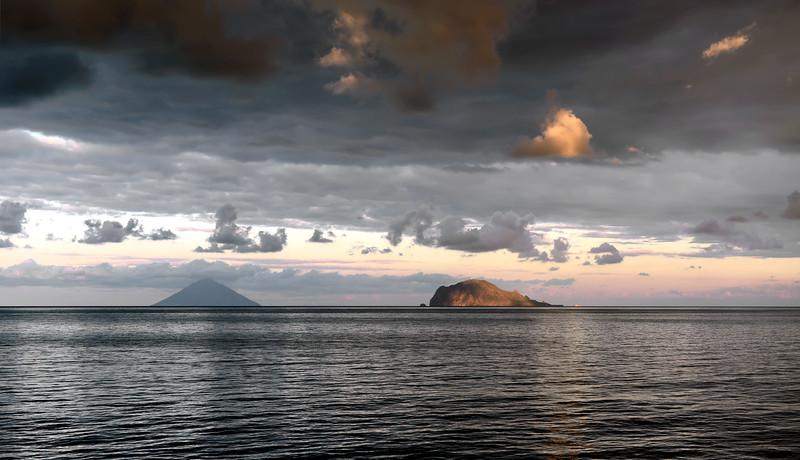 Sunset over Stromboli volcano and Panarea island, Italy