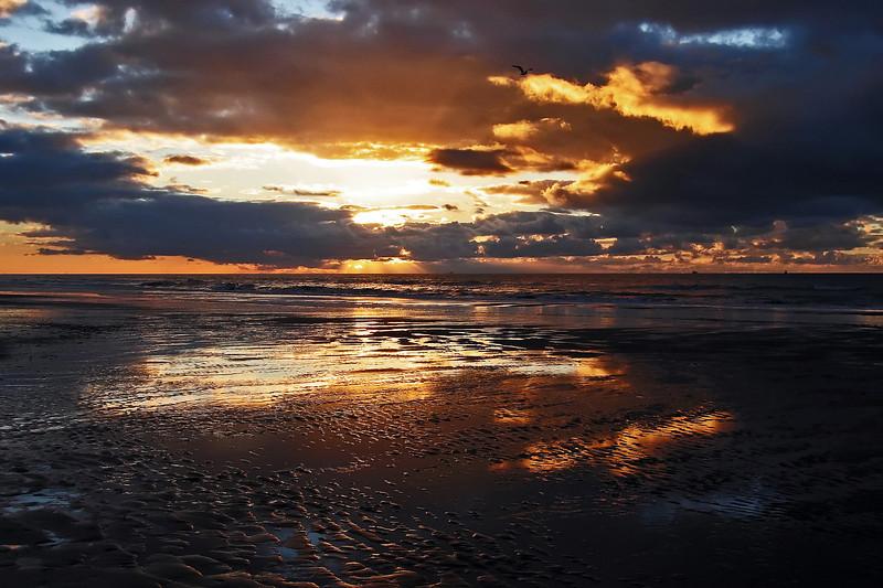 After the winter rain has fallen ....... during low tide on Noordwijk beach, The Netherlands