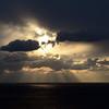 Jacob's ladder and turbulent skies over the sea near Capri, Italy