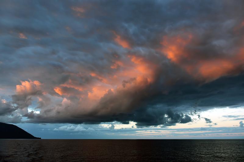 Sunset illuminating cloud formations over Salina island, Italy